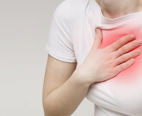 Woman suffering from acid reflux or heartburn, symptomatic indigestion or gastritis disease, panorama; blog: peptic ulcers