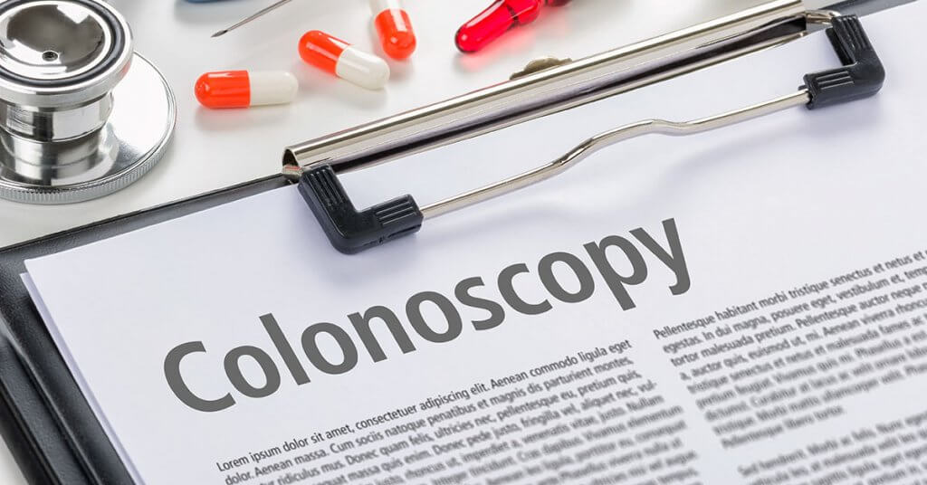 The text Colonoscopy written on a clipboard; blog: Do You Know How Often You Should Get a Colonoscopy?