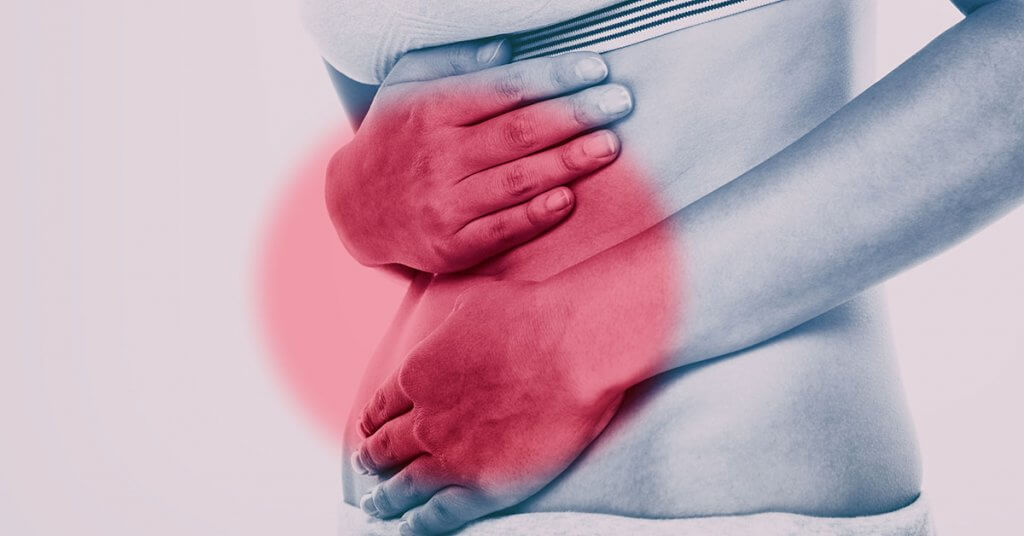 Stomach pain woman with red circle targeting painful area on lower abdomen body. Medical issue of gut health or crohn's disease, ibs syndrome and more; blog: difference between ibs and ibd