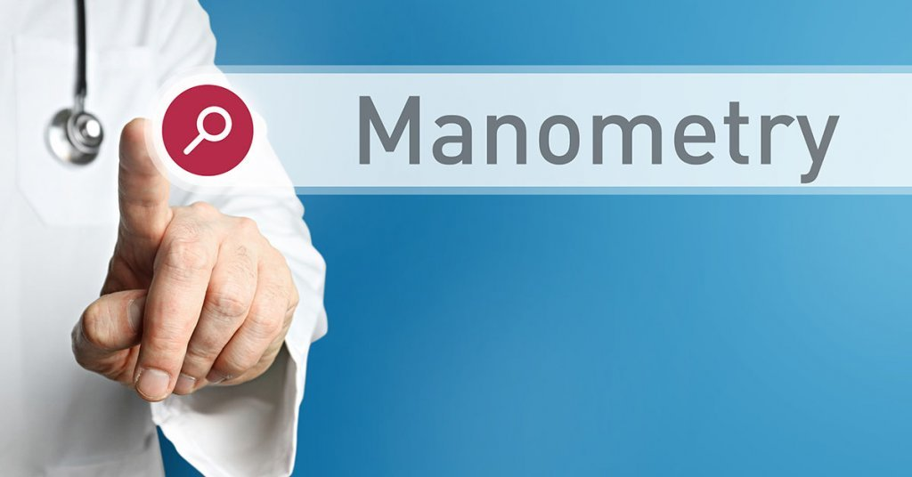 Manometry. Doctor in smock points with his finger to a search; blog: When is Manometry Used?