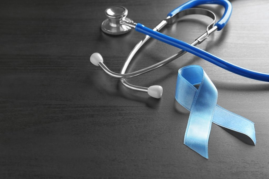 a blue ribbon and a stethoscope to represent colorectal cancer awareness month