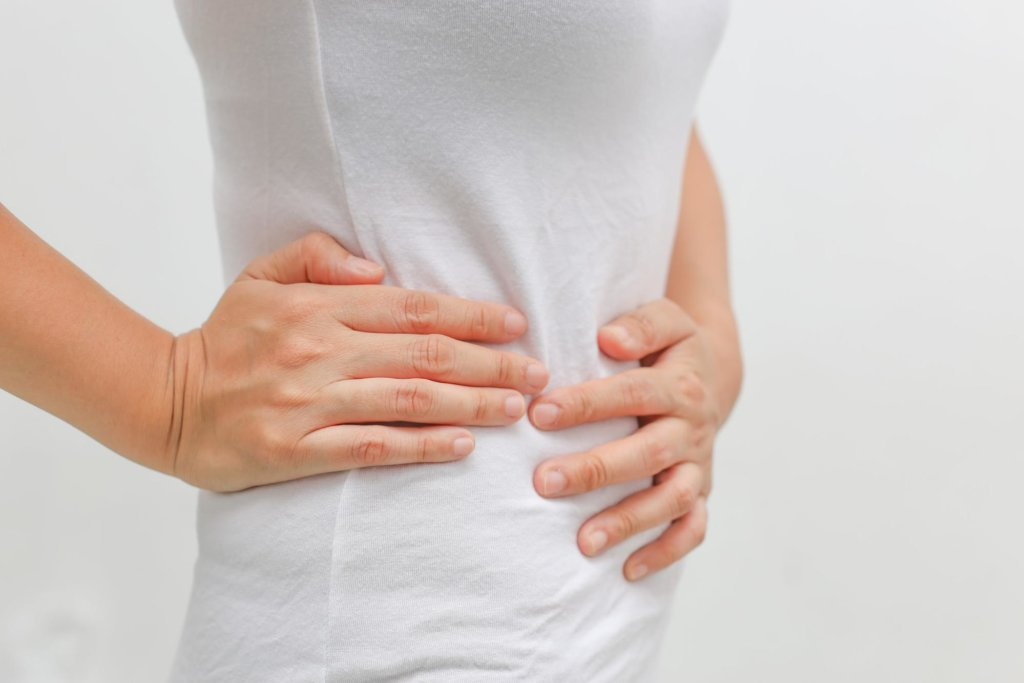 A woman suffering from gastrointestinal issues