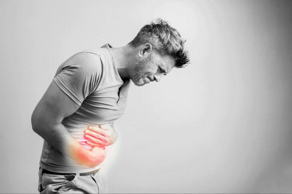 a man with digestion pain to represent the top five gi problems affecting men